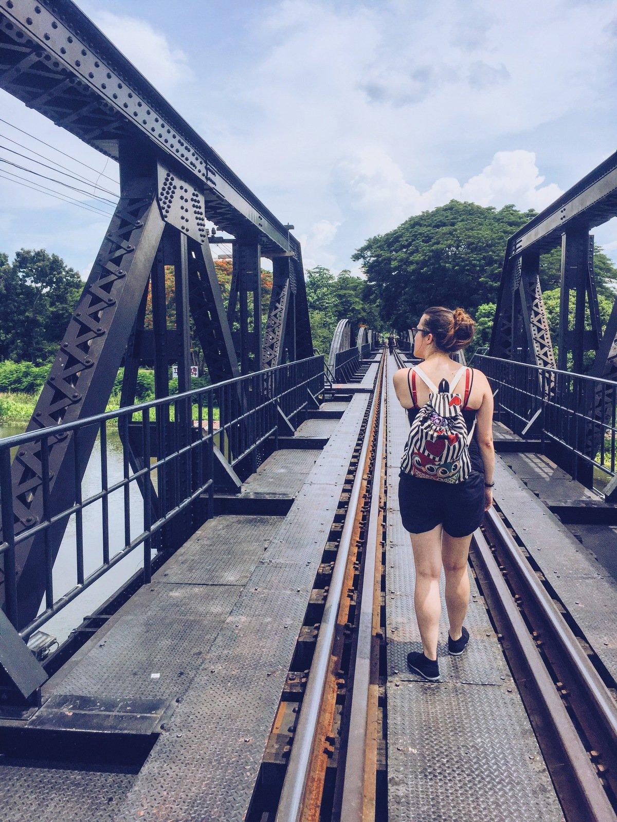 Walking the bridge on the river Kwai in Kanchanaburi Thailand