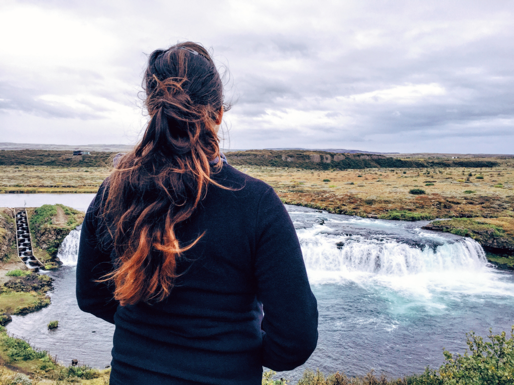 Girl visiting Faxi waterfall in Iceland - things to do with only 2 days in Iceland