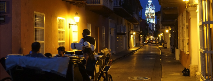 Horse and carriage ride through Colombian streets at night