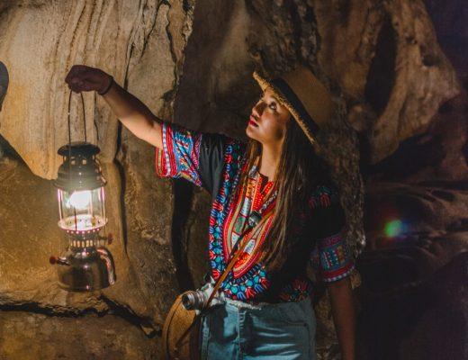 Tana Toraja Funeral traditions, girl in Londa natural cave graveyard