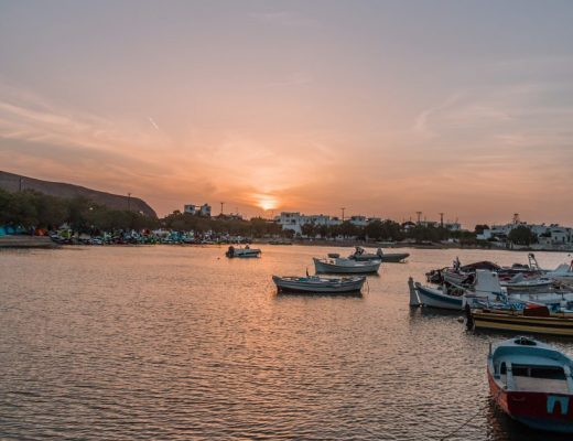 Things to do in Milos - watch sunset from the harbour at Plaka