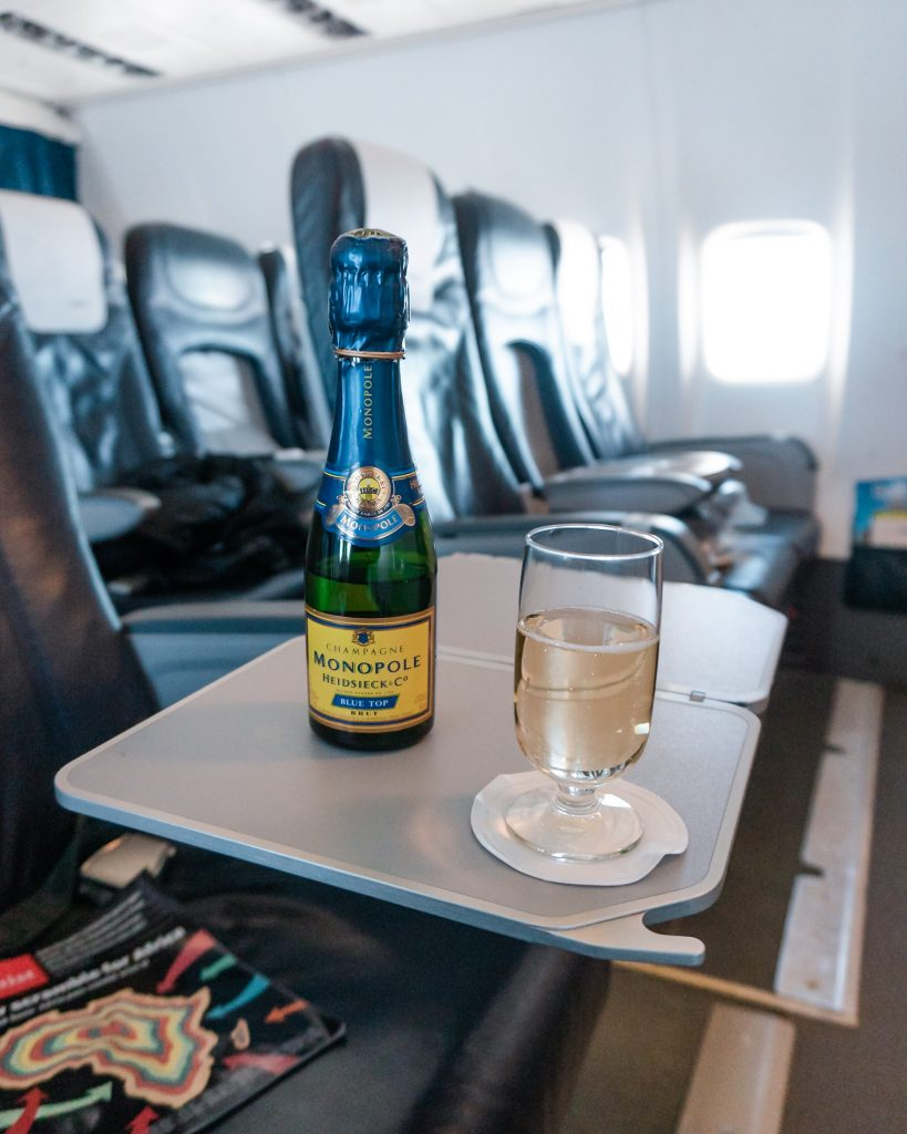 Fly business class with airBaltic for a delicious meal and champagne, wine and other beverages.