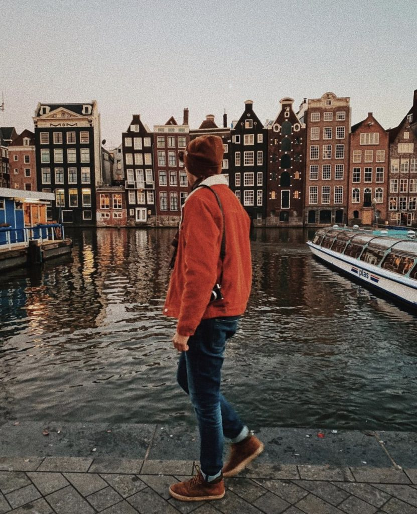 Damrak is one of the best places for photos in Amsterdam!