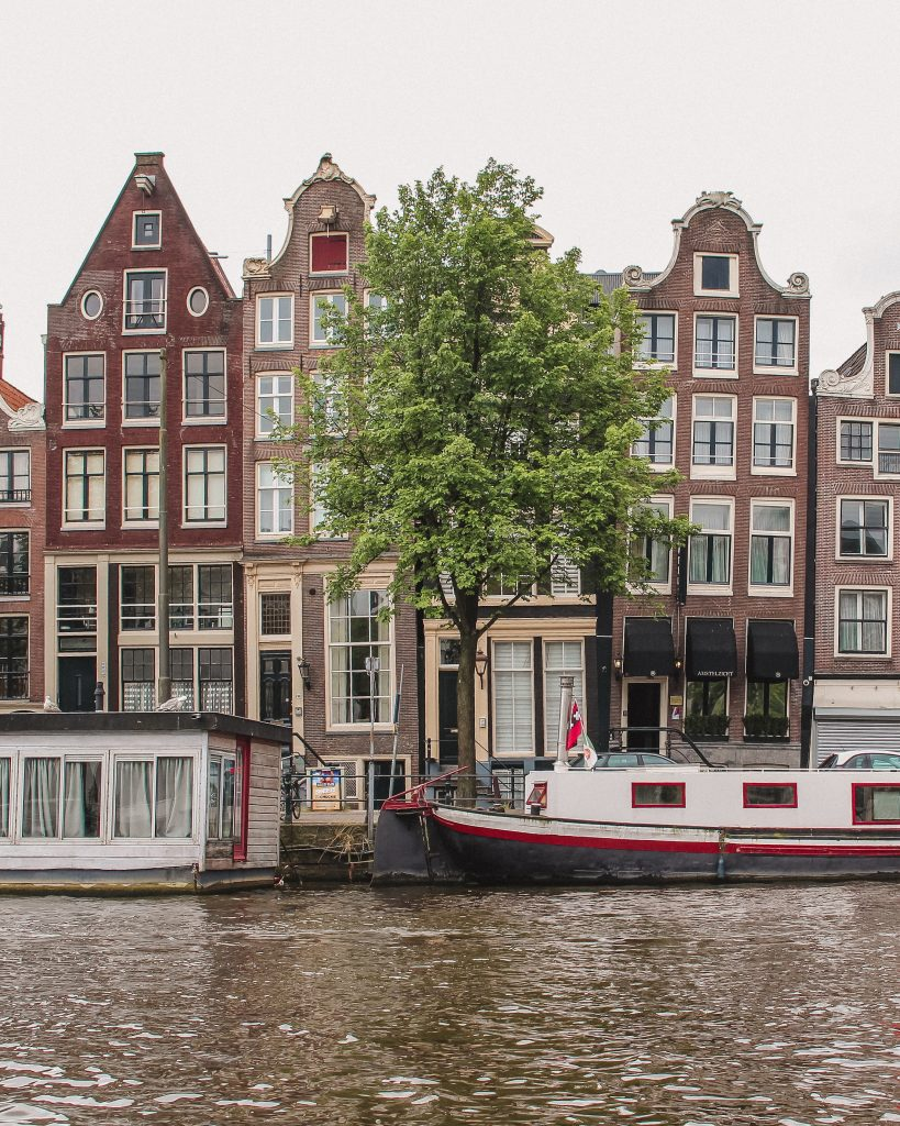 Damrak's dancing houses are one of the most instagrammable spots in Amsterdam
