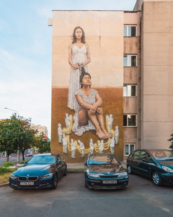More of the amazing street art in Minsk! This beautiful piece is of two young girls and one is braiding the other's hair