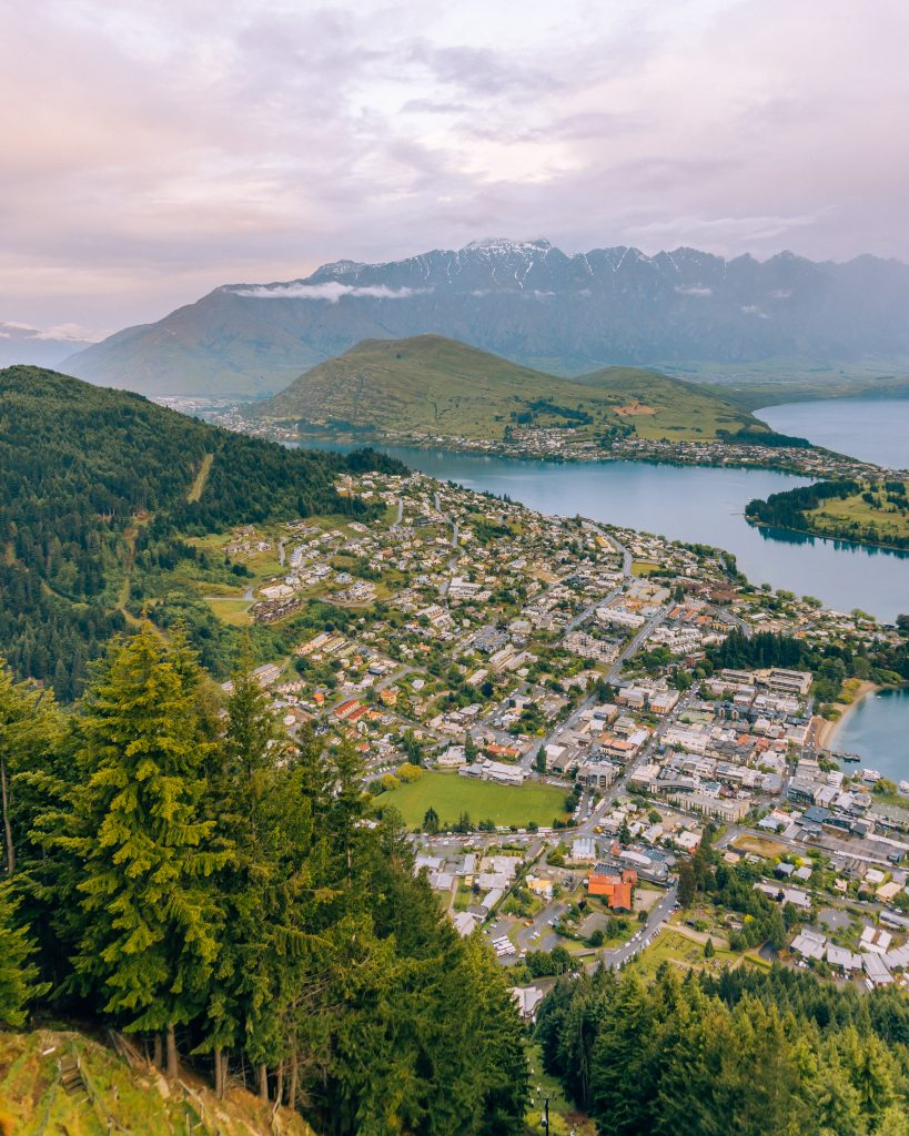 One of the best things to do in Queenstown is the Skyline gondola for amazing views over this South Island city! Don't miss this for sunset views when you explore New Zealand.