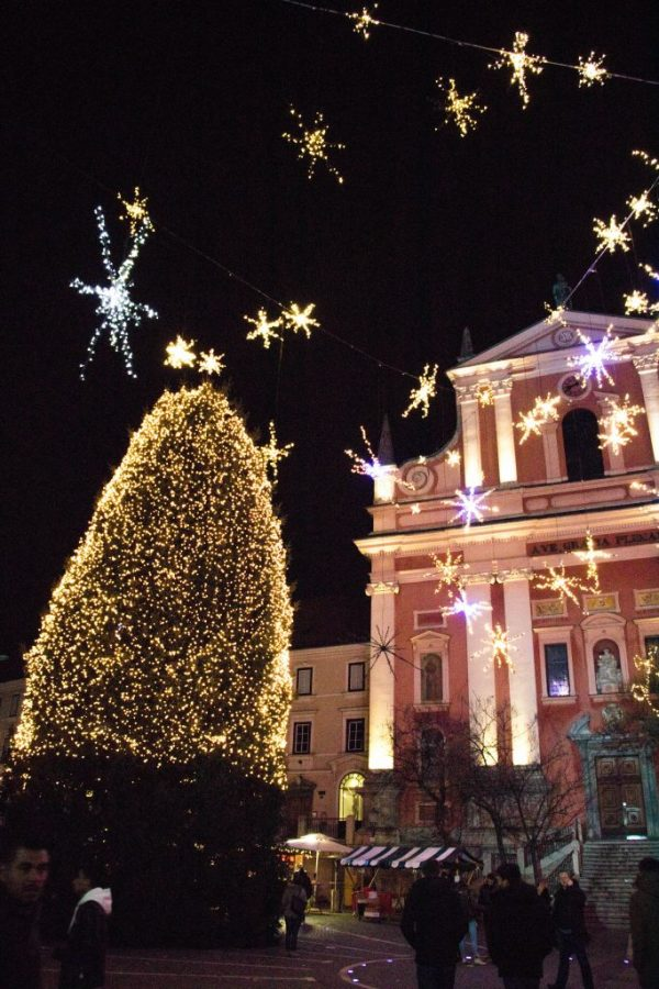 Ljubljana's Pink Church looks beautiful when the Christmas market is on in the the square