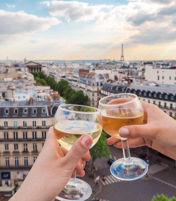 Enjoy a glass of wine at the rooftop cafe of Printemps Haussmann for one of the most beautiful Eiffel Tower views!